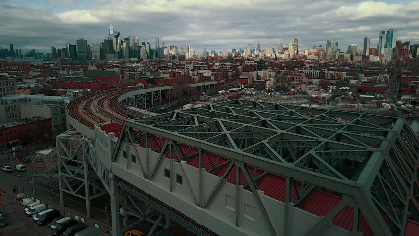 Subway trains cross on elevated track with NYC skyline in background | Shutterstock HD Video #23249809