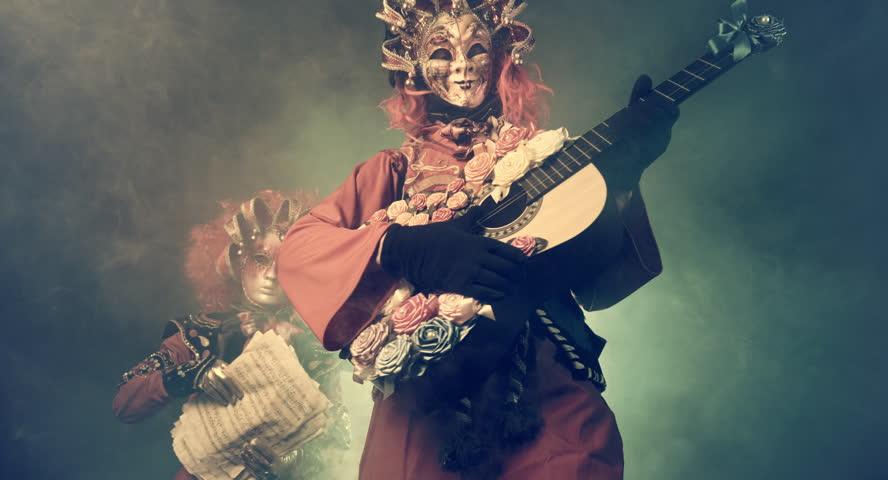 Musicians in Venetian masquerade costumes. Romantic guitarist. | Shutterstock HD Video #23486644