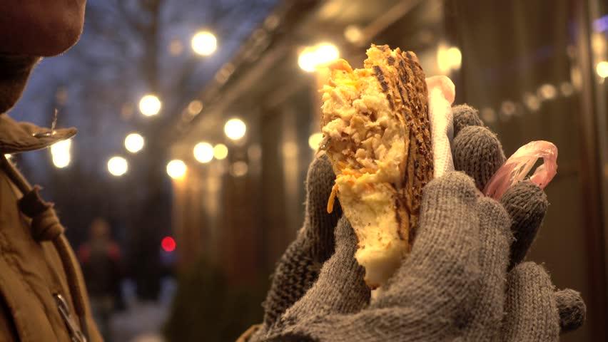 Man eating Doner Kebab at the night street lights - close up #23500459