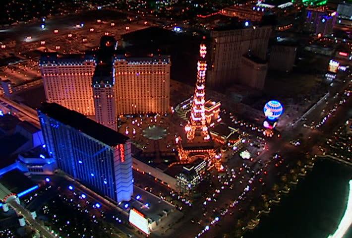 LAS VEGAS - Circa 2002: Aerial view of the replica Eiffel tower and Paris Las Vegas at night - SD stock video clip
