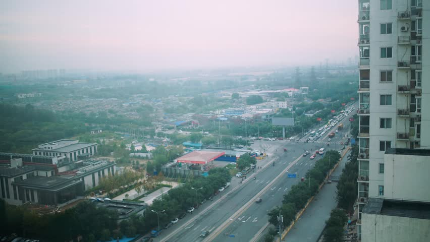 Timelapse view from the heights, the city in haze, traffic movement on the road.  | Shutterstock HD Video #23679766