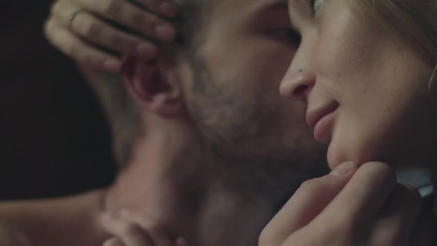 Couple having sweet moments stroking each other intimate scene head close up.  Lovers cuddle kissing. Young woman run fingers through boyfriends hair caressing his ear and man touch girlfriends nose | Shutterstock HD Video #23931820