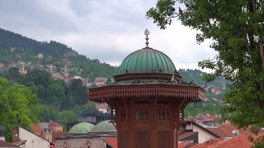 Pigeons sit on the dome of the historic fountain Sebilj Brunnen, Bosnia and Herzegovina, Sarajevo, on June 29, 2015 | Shutterstock HD Video #23966101