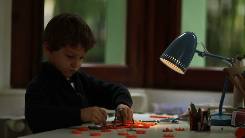 Lamp turns on while young boy plays with toys and figuring out puzzle | Shutterstock HD Video #24020245