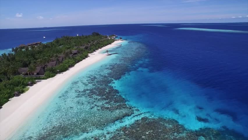 Flying close over tropical sandy beach and waves, Palm on tropical beach, Philippines, Boracay, helipcopter shot, aerial view maldives beach. Aerial shot of a small tropical island in Maldives island.