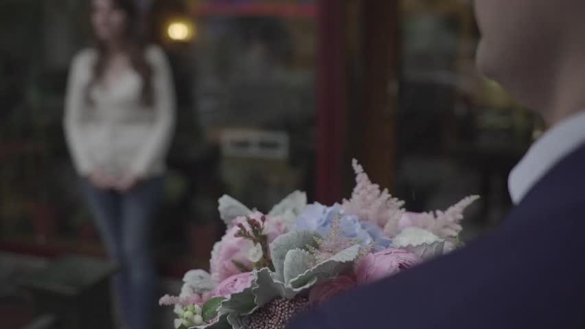 A man gives a girl flowers. | Shutterstock HD Video #24102694