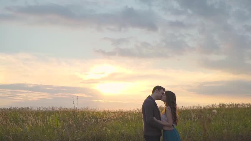 Couple hugging in a field. | Shutterstock HD Video #24102721