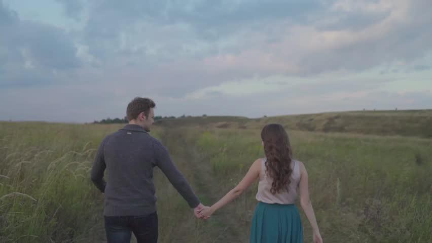 Couple walking in a field. | Shutterstock HD Video #24102766
