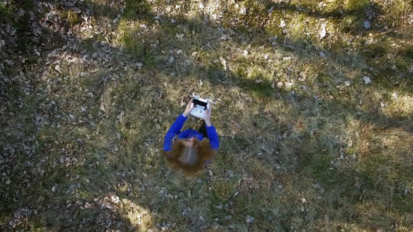 A young girl taking off with a drone | Shutterstock HD Video #24107788