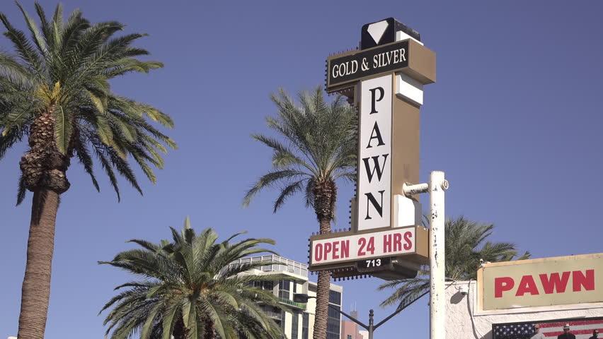 LAS VEGAS, NEVADA - CIRCA 2016: Gold and Silver Pawn shop Exterior daytime establishing shot in Las Vegas, Nevada.  | Shutterstock HD Video #24110938