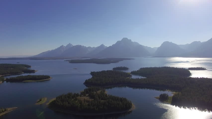 Camera descends and pans to the right slowly revealing more of Jackson Lake | Shutterstock HD Video #24111226