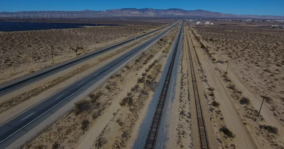 Aerial Drone View Of Railroad Tracks And Highway In 4k 24fps | Shutterstock HD Video #24115717
