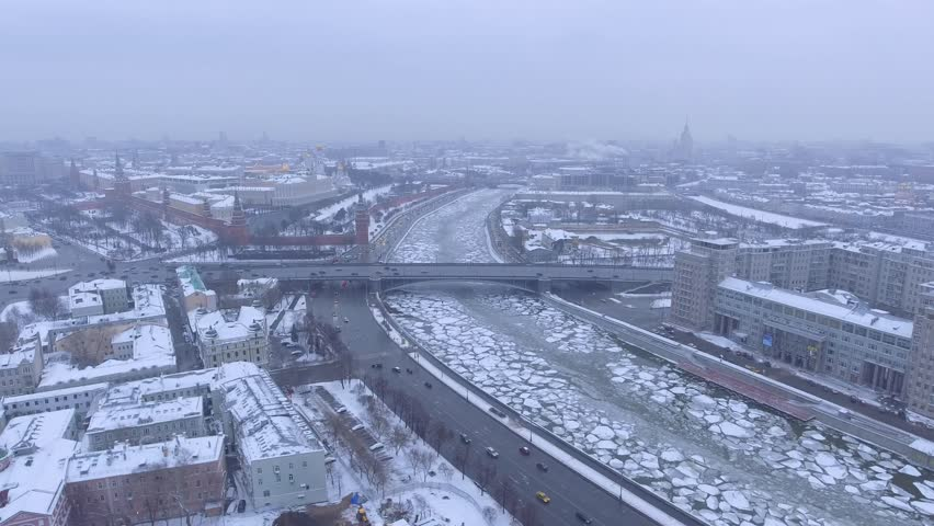 Unique aerial view of frozen winter Moscow kremlin from Aerial Fpv drone. Cinematic 4K footage. Dramatic mood. Day. River ice snow. Bridge. | Shutterstock HD Video #24127228