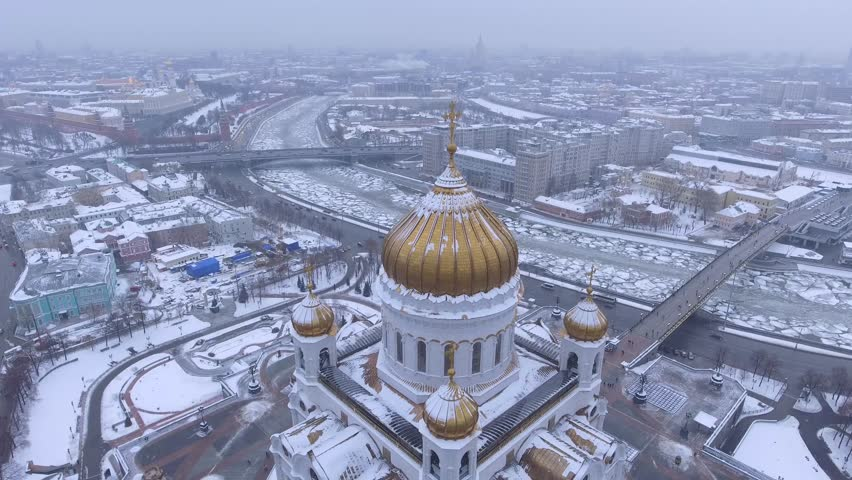 Beautiful Cathedral of Christ the Saviour Unique aerial drone flight around. Snow winter weather. White snow golden domes. Kremlin at background. day. | Shutterstock HD Video #24127273