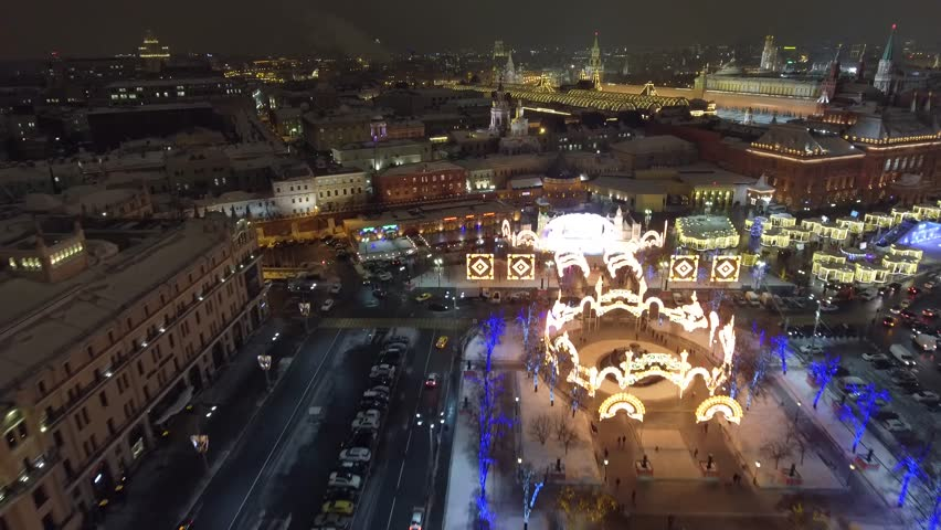 Flight above Theatre square and Red square. Beautiful Moscow city Christmas night illumination. Happy people walk. Aerial drone 4K footage. Winter. | Shutterstock HD Video #24132178