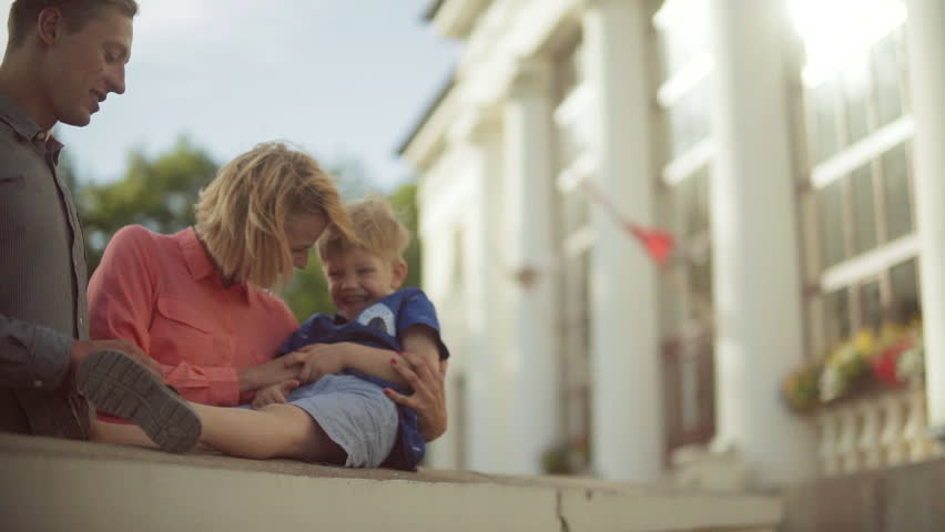 Young parents holding and hugging their adorable child. Beautiful light | Shutterstock HD Video #24132529