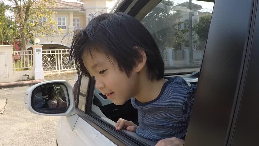Happy Asian boy travels by car, slow motion   Shutterstock HD Video #24133168