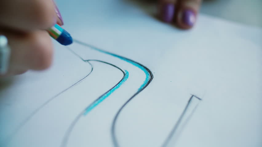 Close-up view of woman s hand coloring layout of shoes with blue pencil. Young designer developing new collection. 4K | Shutterstock HD Video #24141646