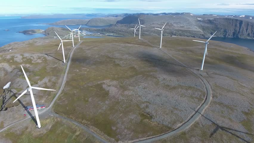 Windmills for electric power production. Arctic View Havoygavelen windmill park, Havoysund, Northern Norway Aerial footage. | Shutterstock HD Video #24161752