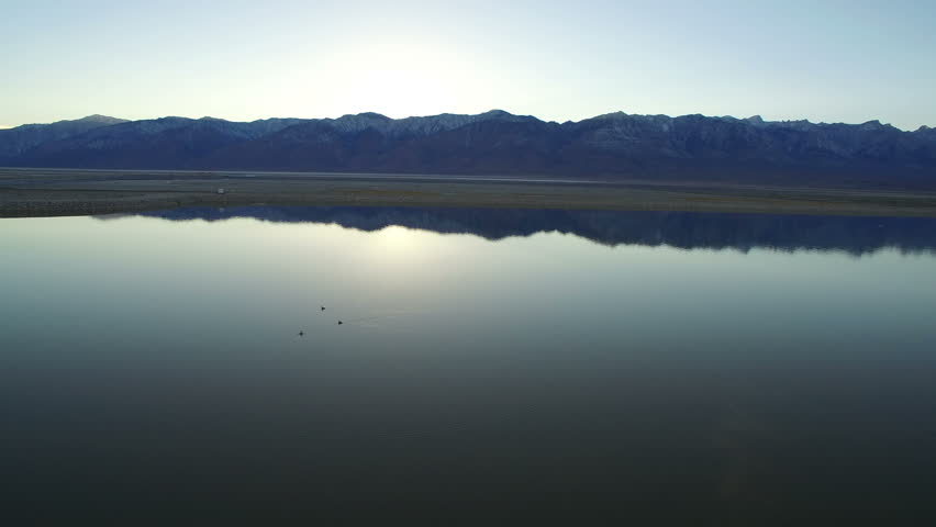 Owens Lake Aerial Sunset 09 Sierra Nevada Mountains | Shutterstock HD Video #24181444