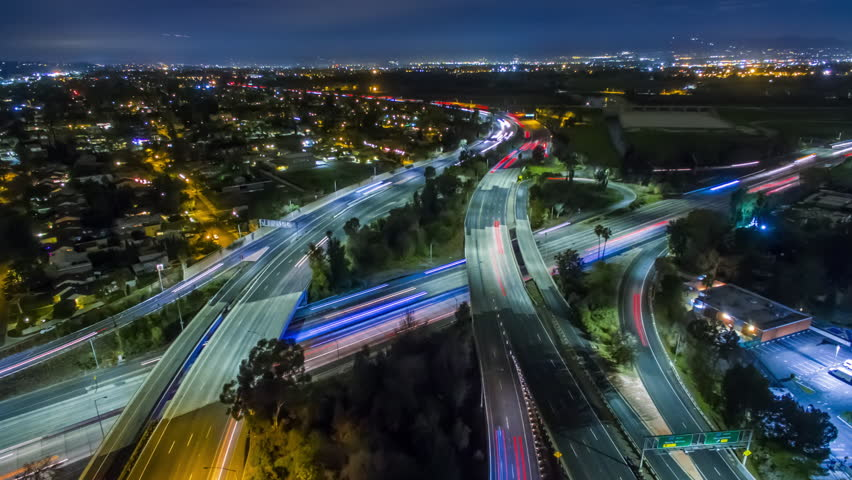 Static aerolapse ( aerial timelapse / hyperlapse ) view of traffic on 405 and 101 freeways interchange at night. Van Nuys, Los Angeles. 4K UHD timelapse background | Shutterstock HD Video #24213574