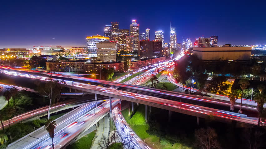 4K Static Aerolapse ( timelapse / hyperlapse ) view of huge traffic on freeway interchange of 110 and 101 freeways in downtown Los Angeles skyline at night.  | Shutterstock HD Video #24213583
