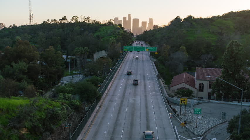 Timelapse and push in to traffic going towards downtown Los Angeles as the light goes from day to night | Shutterstock HD Video #24213682
