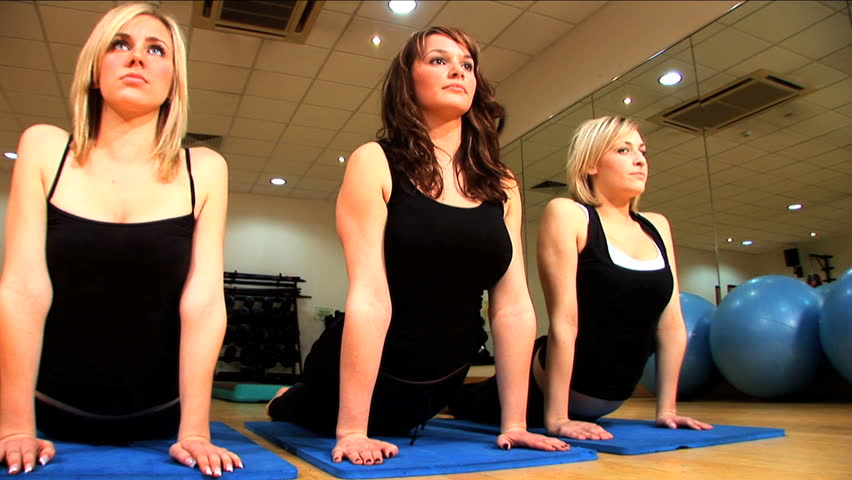 Beautiful girls exercise at the gym - HD stock video clip