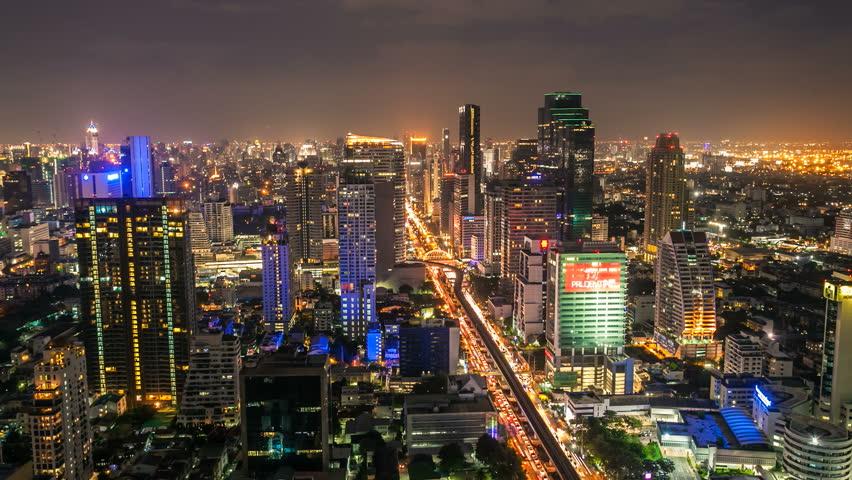 BANGKOK - JUNE 24, 2012: Timelapse view on Sathorn street of skyline at night on June 24, 2012 in Bangkok, Thailand. - HD stock video clip