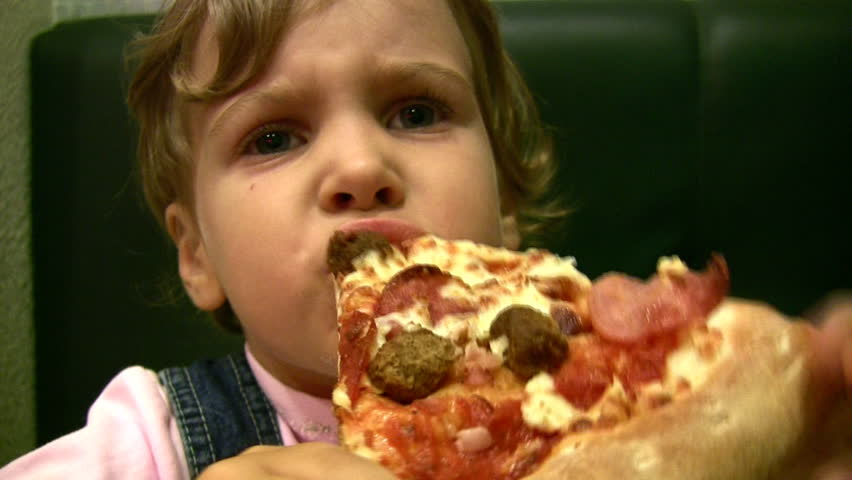 little girl eat pizza  - HD stock footage clip