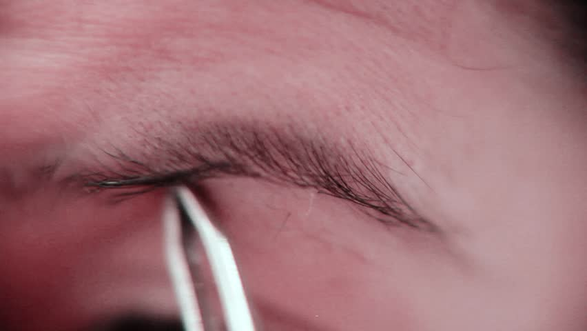 Woman Tweezing and Plucking Her Eyebrows - HD stock video clip