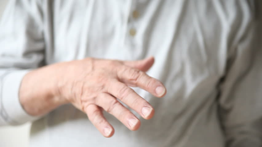 Man With A Tremor In His Hand Stock Footage Video 2495720