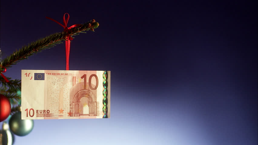 A euro note in a Christmas tree.