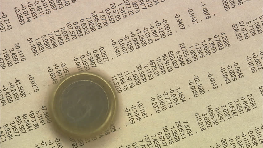 A coin on stock exchange list in a paper. - HD stock footage clip
