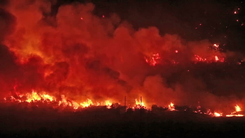 Forest fire burns out of control night in Wood Hollow Canyon.  Flames burning on mountain  rural town in central Utah Sanpete County. Strong winds and very dry season results in extreme fire danger