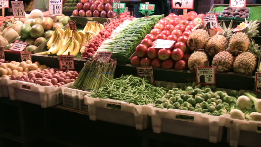Produce stand panning shot showing beautiful, colorful fruits and vegetables. - HD stock footage clip