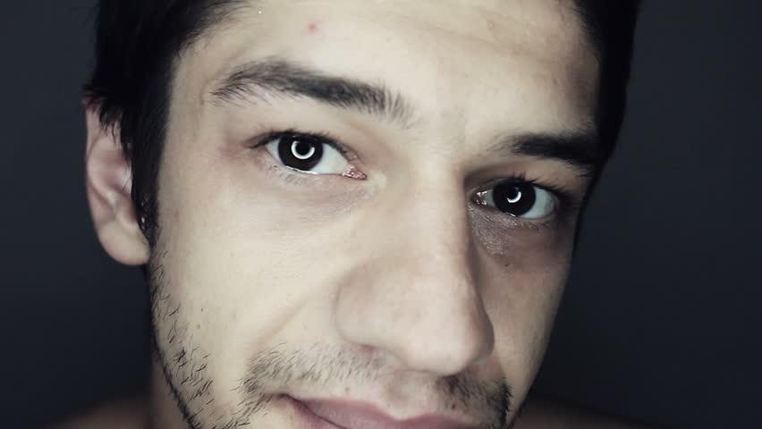 Unshaved Man Gazes into Camera