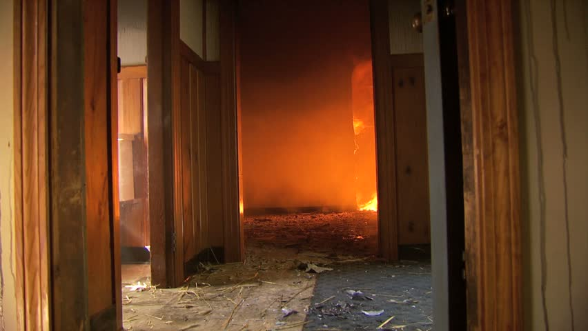 Inside of house on fire with flames, smoke,