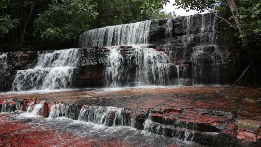 Small falls in the red Jasper canyon in Gran Sabana - Canaima National Park, Venezuela, Latin America - HD stock video clip
