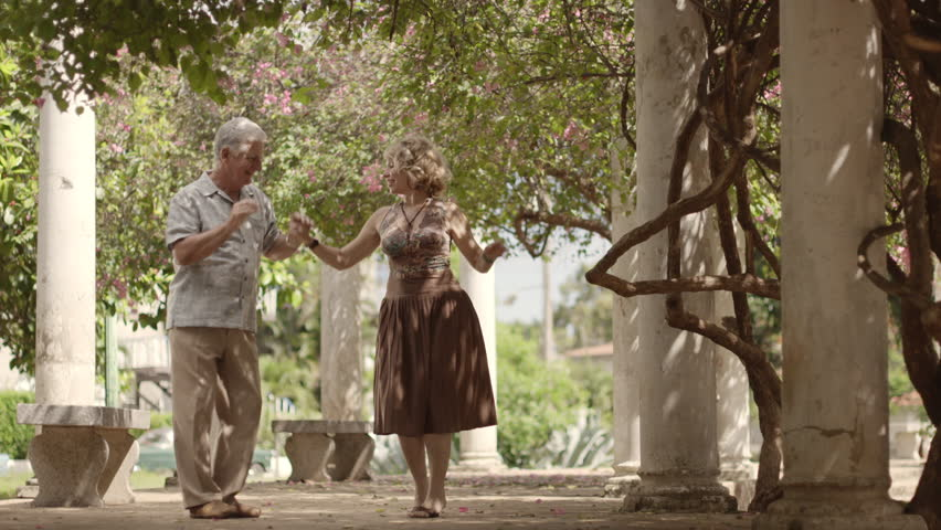 Old retired people and leisure activities, happy senior couple dancing latin american dance for fun