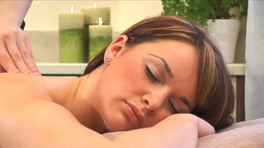 Beautiful brunette girl relaxes during massage at the health spa - HD stock video clip