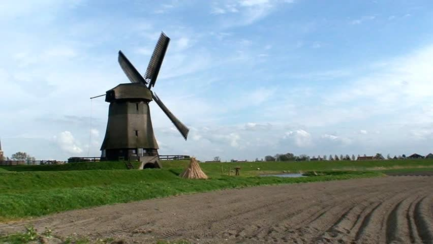 Windmill turning in a field - SD stock video clip
