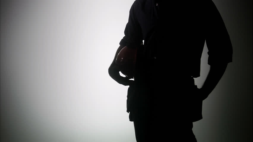 The silhouette of a construction worker. - HD stock footage clip