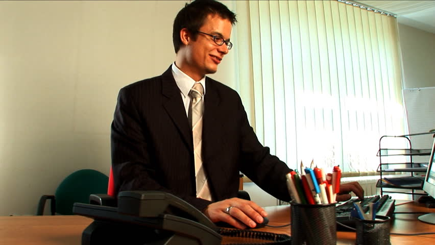 Confident young businessman in the workplace - HD stock footage clip