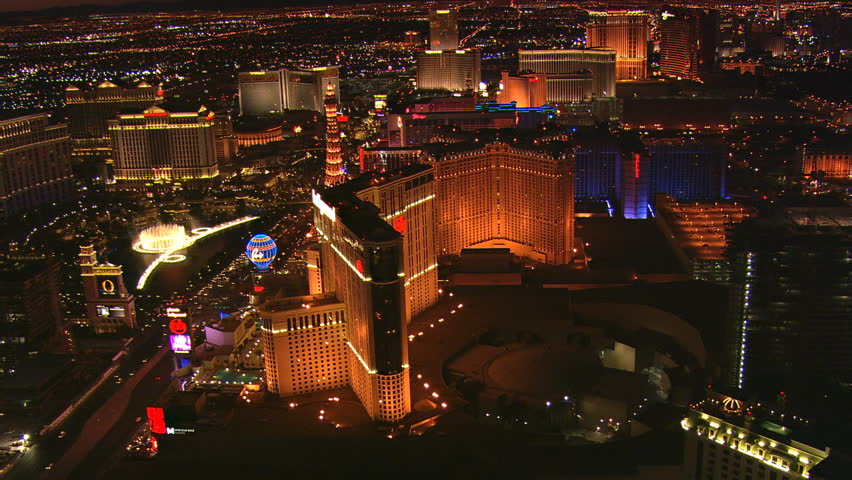 Orbiting nearby casinos for a view of the Bellagio's water show in nighttime Las Vegas. Shot in 2008. | Shutterstock HD Video #26822926
