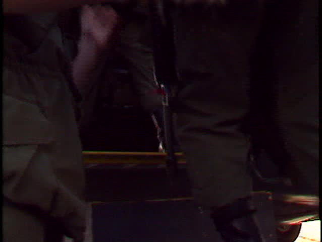 para soldiers walking to C130 Hercules transport plane stepping aboard (BetacamSP, good audio) - SD stock video clip