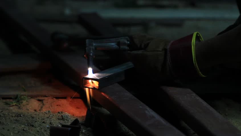 Gas cutting metal using acetylene torch - HD stock video clip
