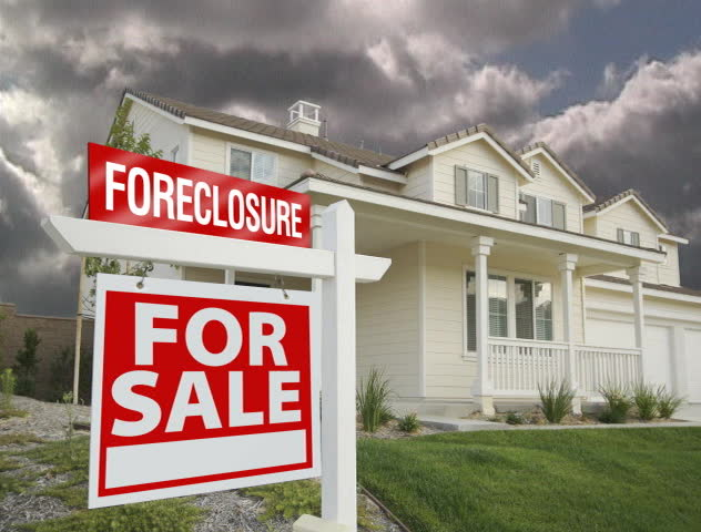 Foreclosure For Sale Sign, Home and Ominous Time Lapse Clouds.