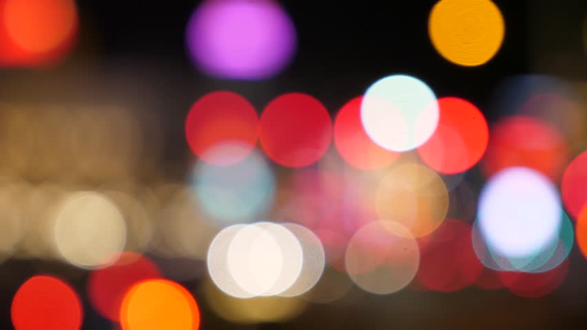 An out of focus shot of people and lights in a busy city at night | Shutterstock HD Video #26965369