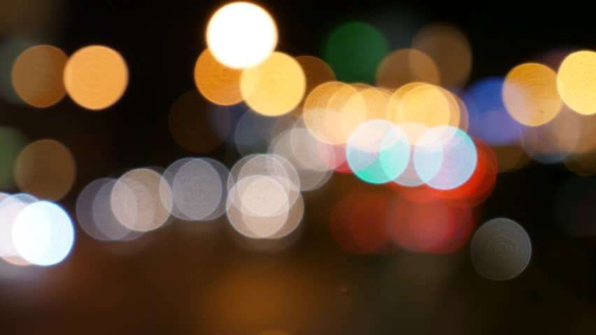 An out of focus shot of people and lights in a busy city at night | Shutterstock HD Video #26965378